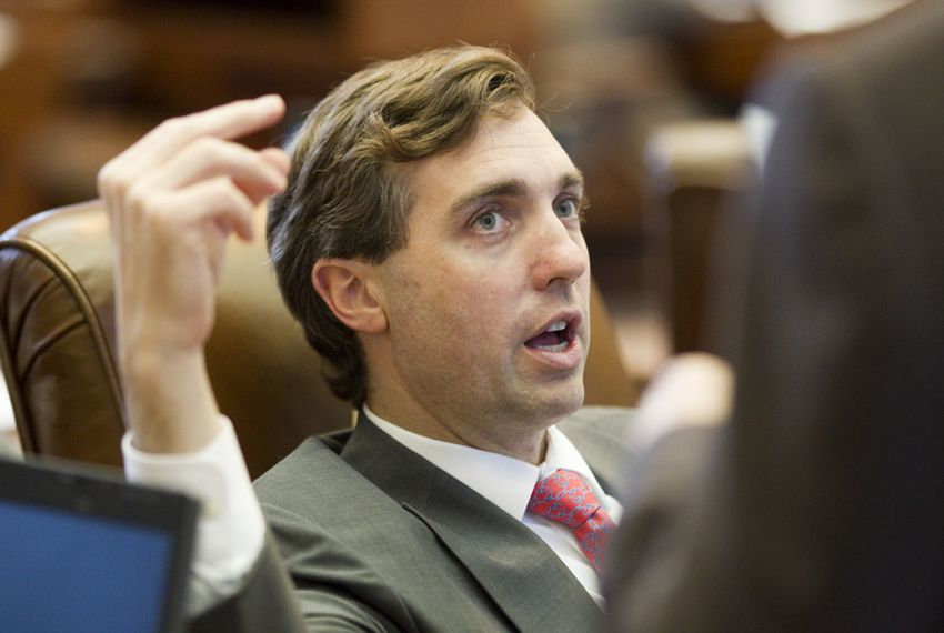State Rep. Van Taylor, R-Plano, talks with a member on the House floor on May 16, 2011.