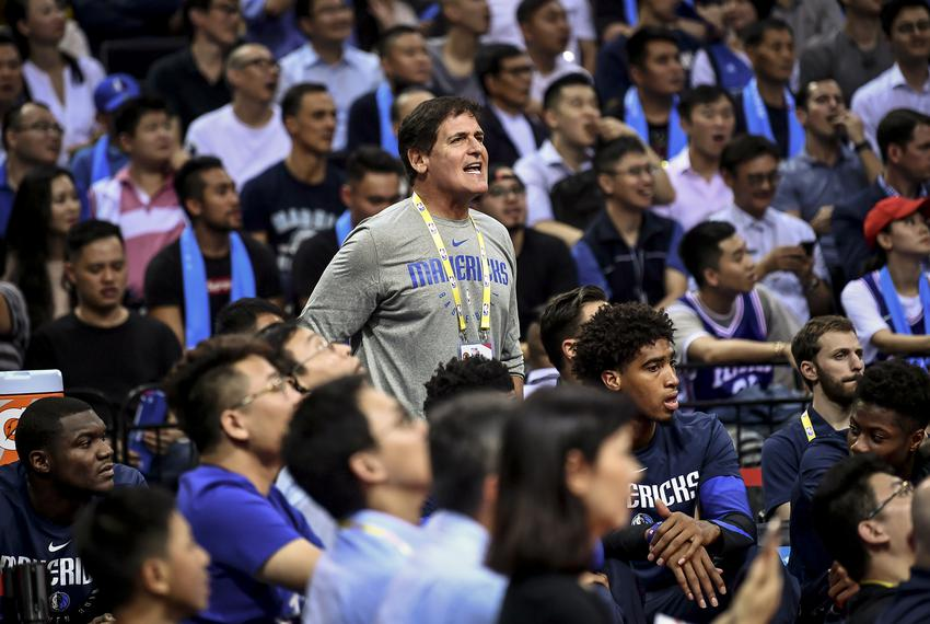 Mark Cuban, center, the owner of Dallas Mavericks, before an NBA China Games between the Dallas Mavericks and Philadelphia 7…