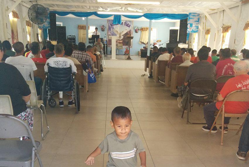 """Junior"" Silva walks through the chapel and the Senda de Vida immigrant shelter in Reynosa, Tamaulipas on August 24, 2014."