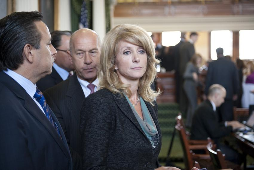 State Sen. Wendy Davis, D-Fort Worth, leaving the Senate chamber with colleagues Sen. Carlos Uresti, D-San Antonio, and Se...