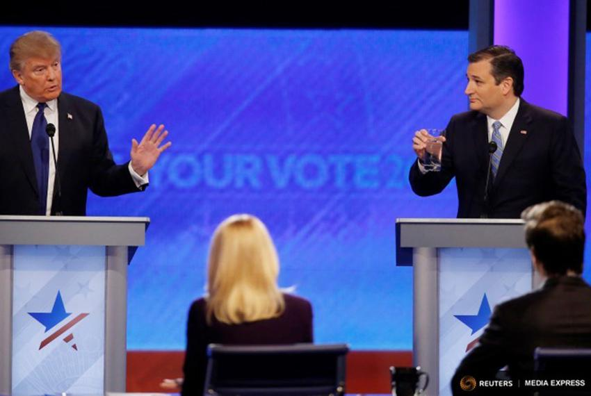 Presidential candidates Donald Trump and Ted Cruz at the GOP debate at Saint Anselm College  in Manchester, New Hampshire on…