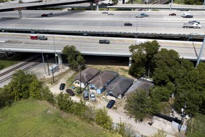 An aerial view of four houses next to I-45 near downtown Houston on Sept. 16, 2019.