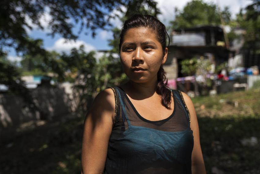 Honduran migrant Norma Leticia López, 21, poses for a photo on Oct. 26, 2018, in front of the migrant shelter Casa del Camin…