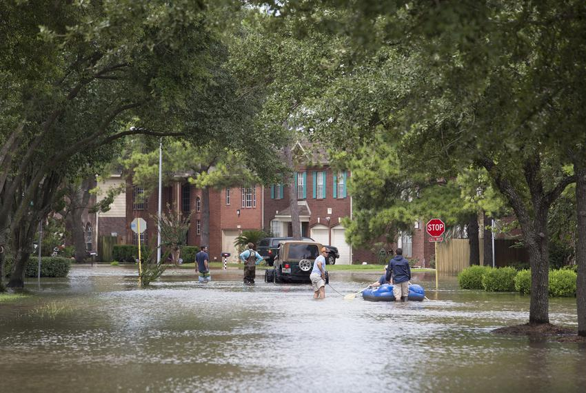 Flood waters in a neighborhood along Eldridge Parkway flooded by waters released from the Addicks Reservoir, in Houston on W…