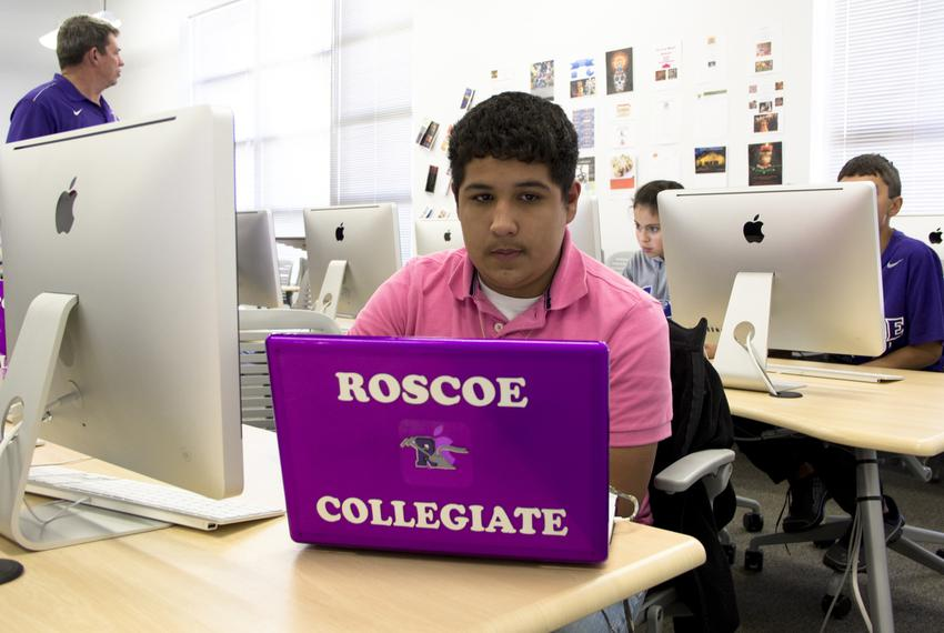 A high school student in Roscoe ISD, which has provided a laptop for every student with money from wind farm subsidies.