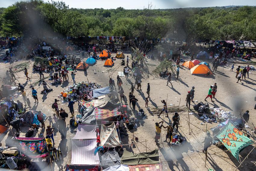 Makeshift shelters at a temporary migrant camp under the international bridge in Del Rio on Sept. 17, 2021.