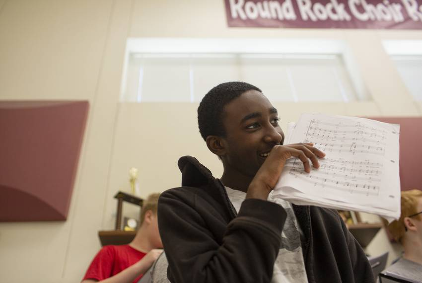 Addison Savors, a junior at Round Rock High school, sings in his choir class on April 26, 2019. The expansion of the marsh...