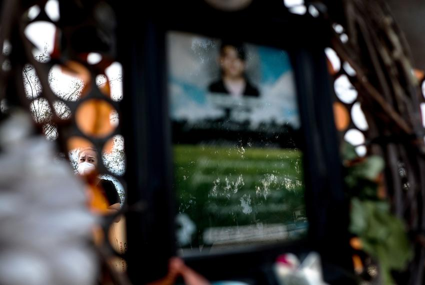 Nubia Legarda, visits a memorial honoring the victims of the Walmart shooting at Ponder Park in El Paso.