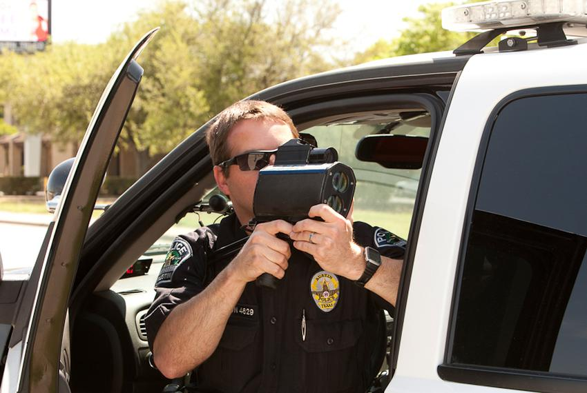 Austin Police Department Senior Patrol officer S. Boughton uses radar to monitor vehicles along stretch of Austin highway ...