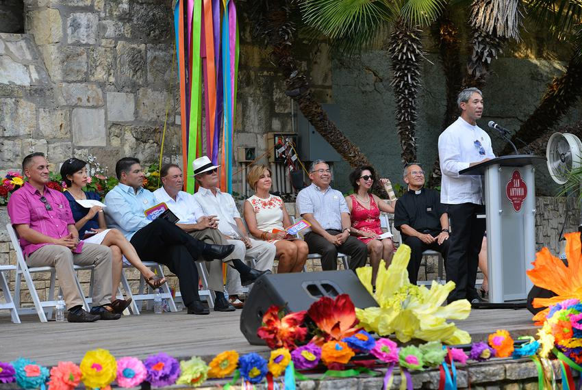 As newly sworn-in city council members look on, San Antonio Mayor Ron Nirenberg speaks to the crowd at his Wednesday swearin…