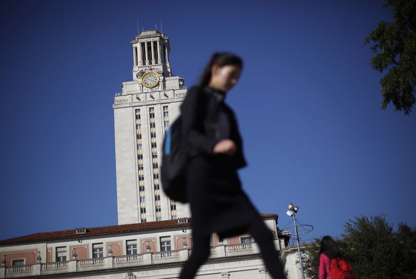 University of Texas at Austin students pass by the Main Building on their way to and from classes.