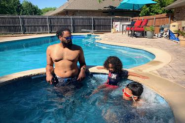From left, Joseph Norman relaxes in the pool at his in-laws' house in Granbury with his sons Joseph and Maxwell.