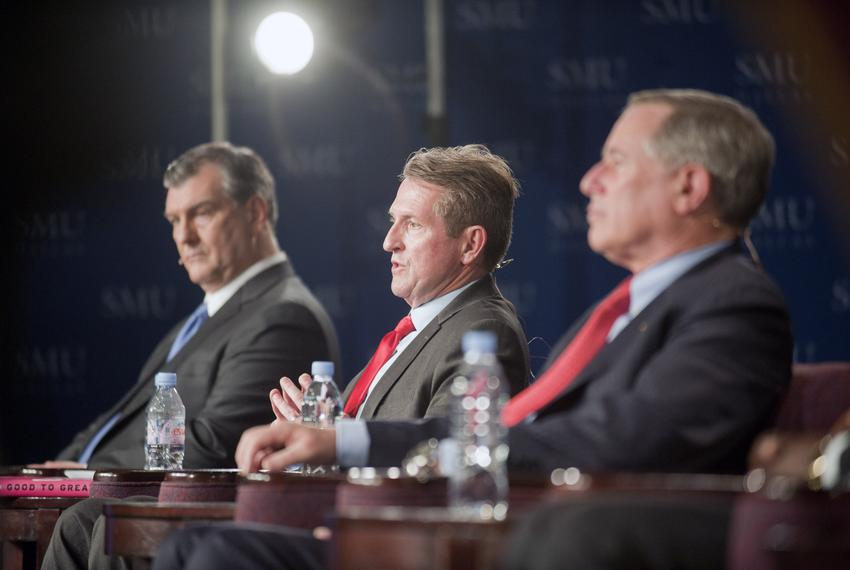 Dallas Mayoral candidate David Kunkle speaks during a televised debate flanked by opponents Mike Rawlings and Ron Natinsky a…