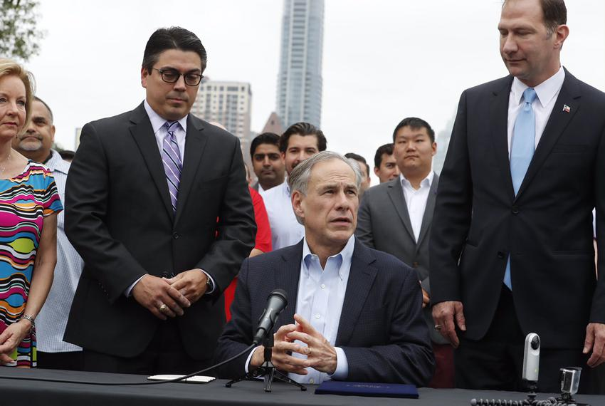 At an outdoor bill-signing ceremony in Austin, Gov. Greg Abbott tells reporters he'll make an announcement on a special se...