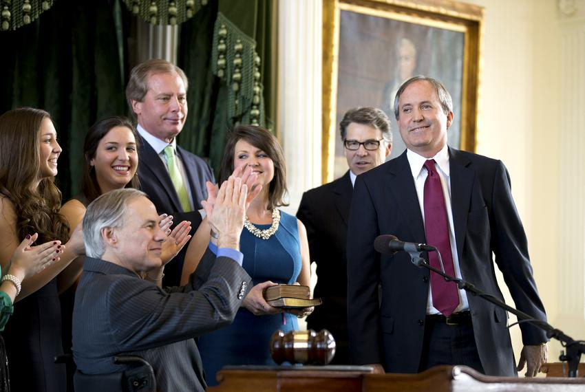 Ken Paxton receives an applause as he is sworn into office as Attorney General. Paxton replaced outgoing Attorney General Gr…