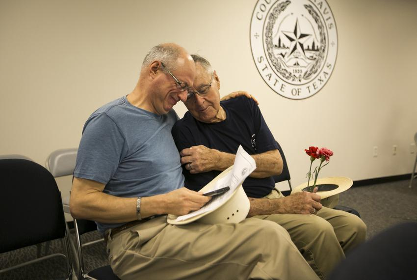 Jeff Sralla, left, with his partner of 28 years, Gerard Gafford, at the Travis County Clerk's office, where they applied for…