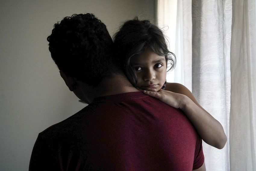 Heyli and her dad, Carlos, pictured in their apartment in Los Angeles, spent nearly two months separated from each other after they sought asylum at the Texas border.