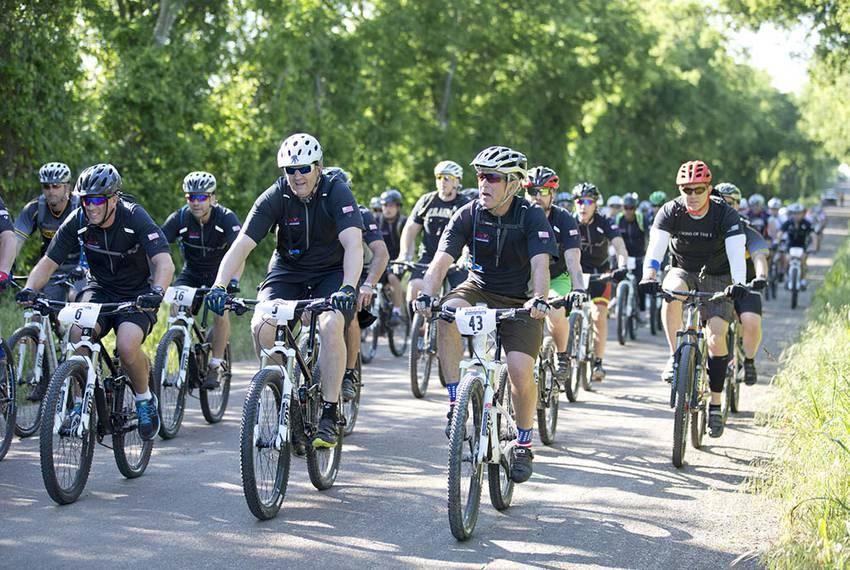 Riders navigate Prairie Chapel Road at former President George W. Bush's Prairie Chapel Ranch outside of Crawford.