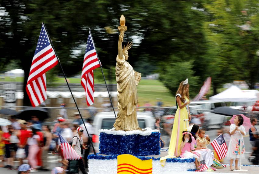 A Statue of Liberty replica passes by at a parade during Fourth of July Independence Day celebrations in Washington, D.C. on…