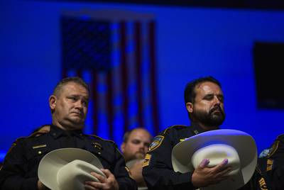 Police officers at a service held for Deputy Sandeep Dhaliwal of the Harris County Sheriff's Office. Dhaliwal was shot and killed while making a traffic stop on Sept. 27, 2019.