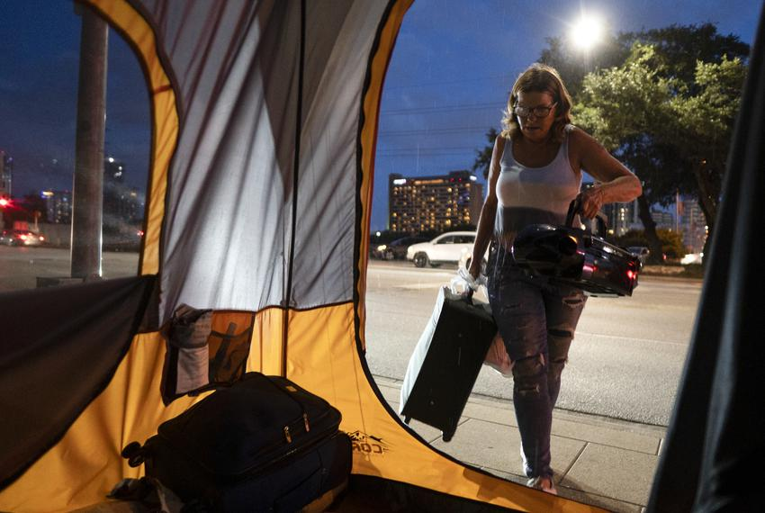 Christina Jezzizki, 58, starts preemptively moving her belongings to avoid being arrested for camping in front of Austin Cit…