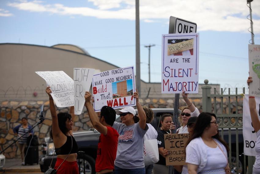 """Demonstrators in a parking lot near the Mexico border during the """"Families Belong Together"""" in el Paso on June 30, 2018."""