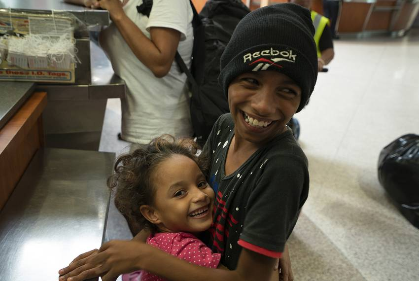 Jose and his sister, Genesis, smile and play at the McAllen Central Station. The family waited for days on the Gateway International Bridge in Brownsville t...