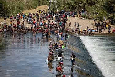 Migrants cross the Rio Grande between Del Rio, Texas and Ciudad Acuña, Mexico, on Sept. 16, 2021.