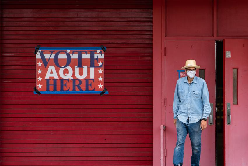A man exits Toney Burger stadium in South Austin where early voting has begun for the July 14th runoff and special electio...