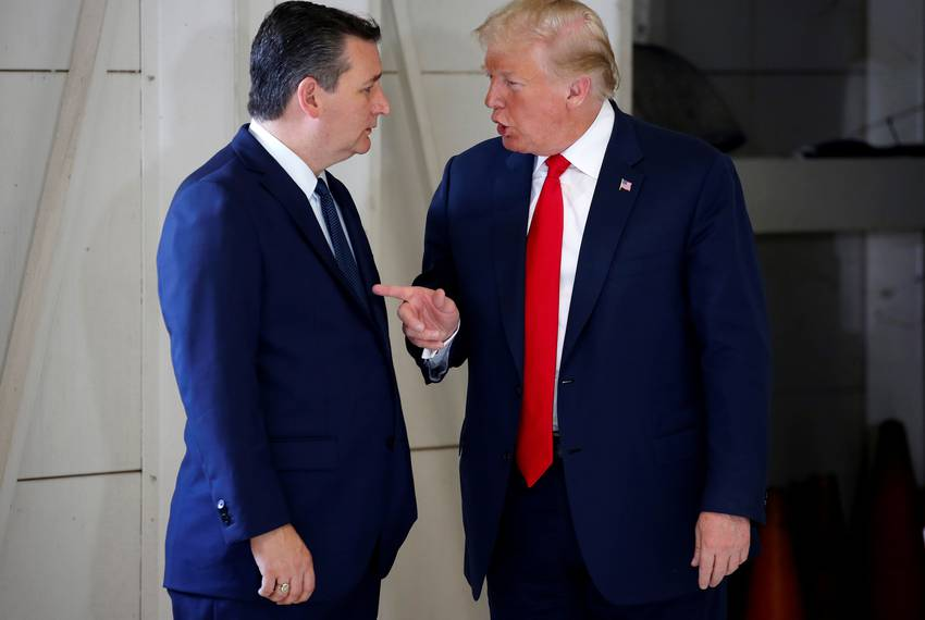 President Donald Trump speaks with Sen. Ted Cruz, R-Texas, before a meeting with families of the Santa Fe school shooting ...