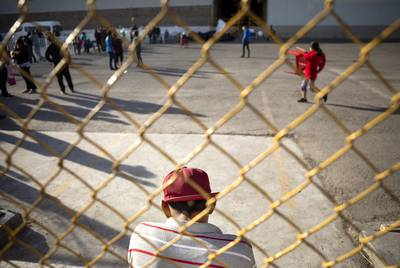 A young man sits by a fence of the migrant shelter in Piedras Negras, Coahuila. A week before, the shelter held an estimated 1600 migrants. Only several hundred remained as of Feb. 18, 2019.