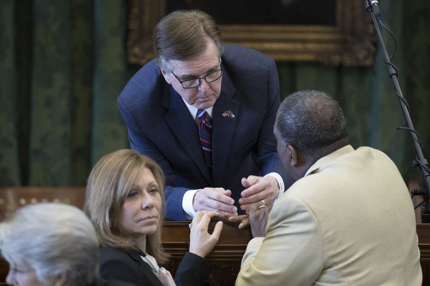 Lt. Gov. Dan Patrick confers with State Sens. Joan Huffman, R-Houston, Royce West, D-Dallas, on March 14, 2017.
