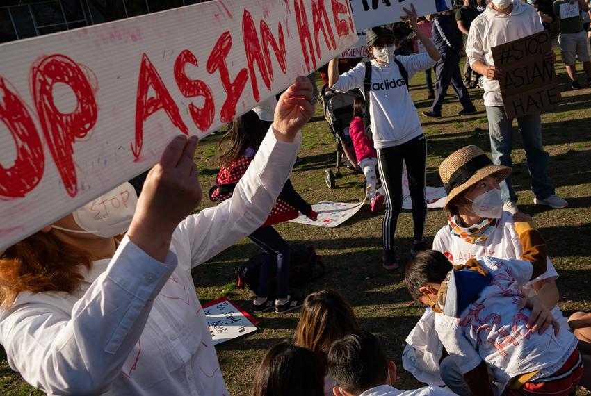 Amanda Zhang, right, attends a rally at Discovery Green on March 20, 2021, in Houston. People gathered for the Stop Asian Ha…