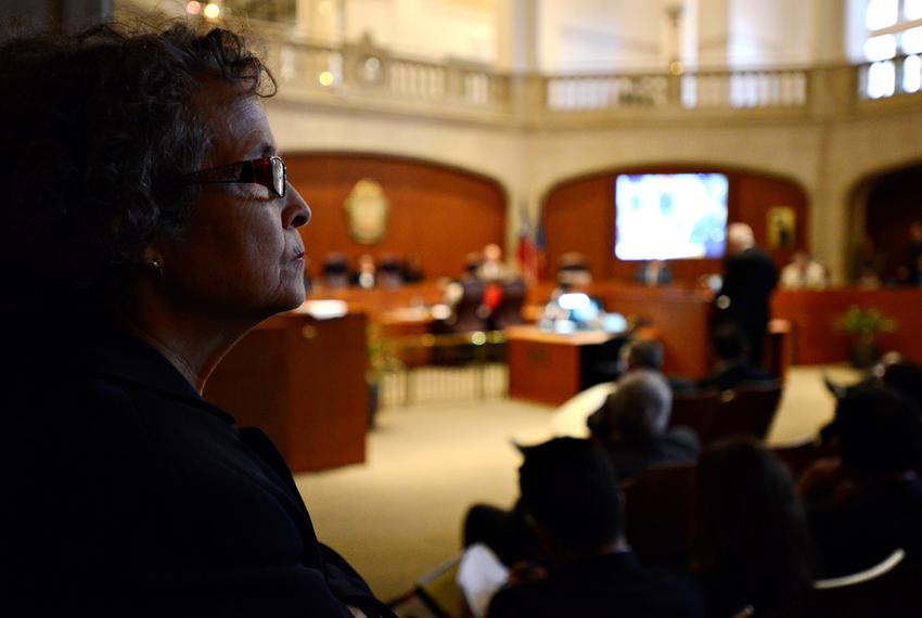 League of Independent Voters of Texas Executive Director, Linda Cirtus, looks onto the San Antonio City Council meeting mome…