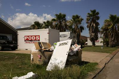 Camper trailers and storage containers are a common sight in the front yards of many Port Arthur residents as people try to repair their Harvey-damaged homes.
