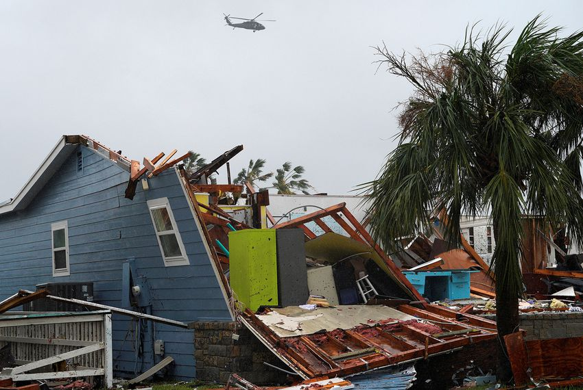 A military helicopter flies over a destroyed house after Hurricane Harvey struck in Rockport, Texas, August 26, 2017.
