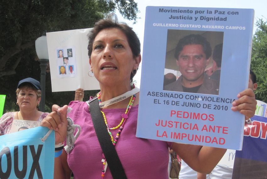 A member of the Caravan for Peace with Justice and Dignity marches on the state Capitol Saturday, August 25, 2012.