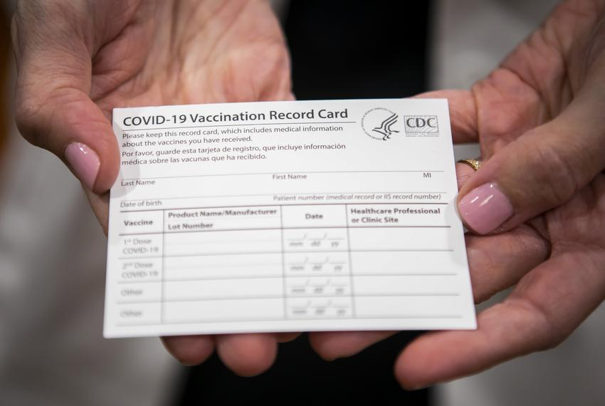 Dr. Annamaria Macaluso Davidson holds a COVID-19 vaccine registration card at Memorial Hermann Hospital in the Medical Cente…