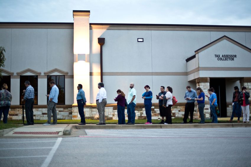 Voters wait in line before polls open on Election Day in Round Rock on Nov 8, 2016.