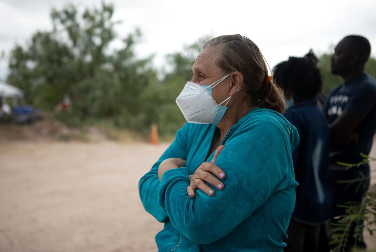 TKTK watches as her husband is arrested by a Texas Department of Public Safety official near the U.S. and Mexico border in Del Rio on July 23, 2021.