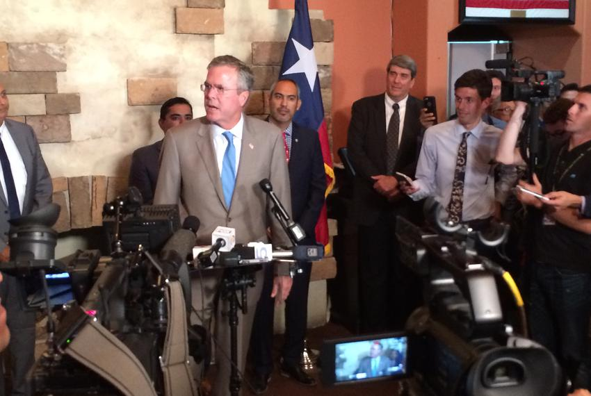 Former Florida Gov. Jeb Bush speaks with reporters Monday in McAllen. He brought his presidential campaign to the Rio Grande…