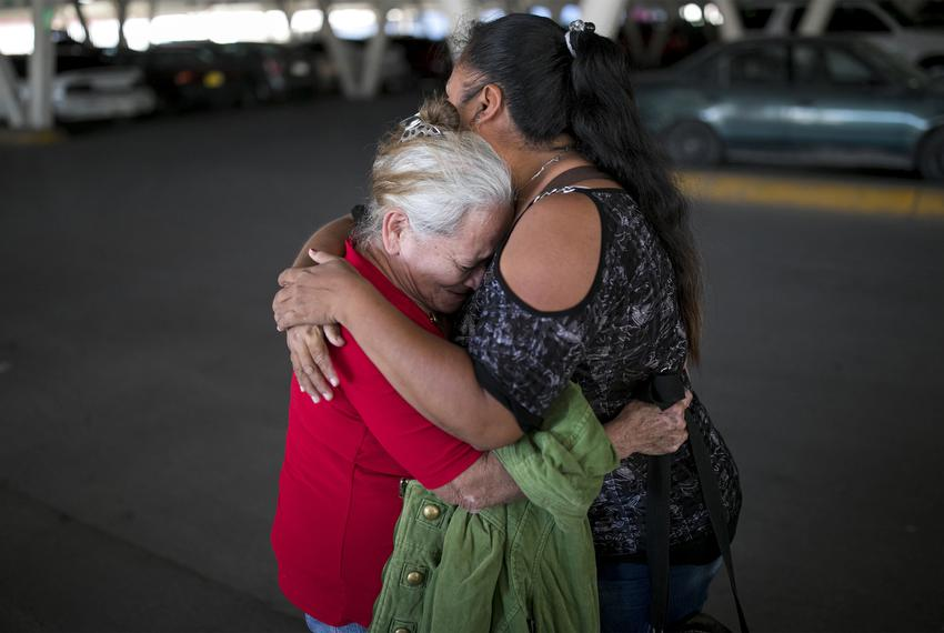 Bertha, left, cries as she says goodbye to Elena before walking to the international bridge to try to get an interview with …