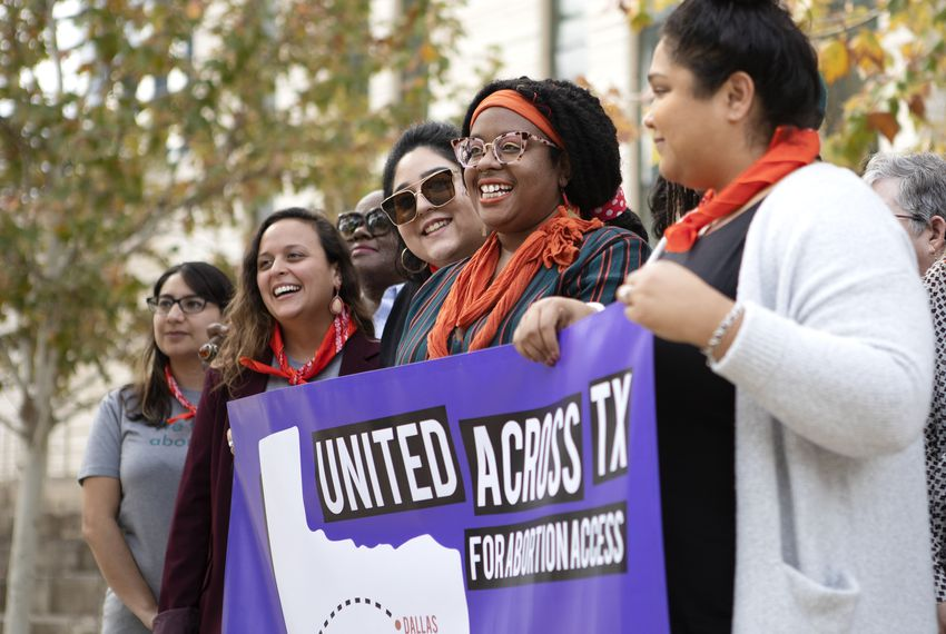 Abortion access advocates pose for a photograph outside of  the U.S. District Court in Austin. The court is set to weigh in on whether abortion funds and health care providers can challenge restrictions to abortion access. Miguel Gutierrez Jr. / Texas Tribune.