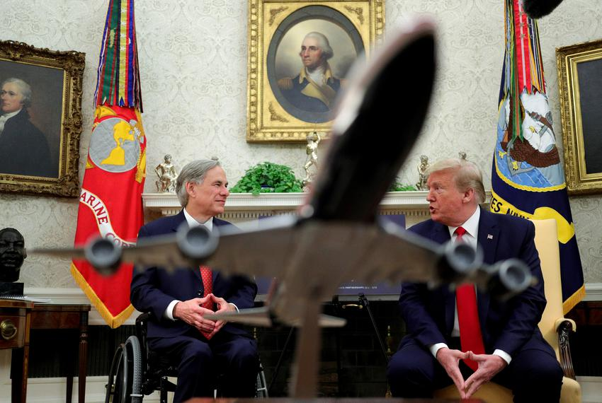 President Donald Trump speaks with Gov. Greg Abbott  in the Oval Office on May  7, 2020.
