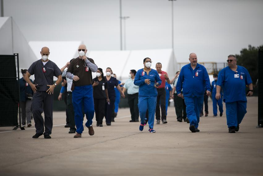 Medical personnel during a media tour of a medical shelter at NRG Park in Houston on April 11, 2020. The facility was built …
