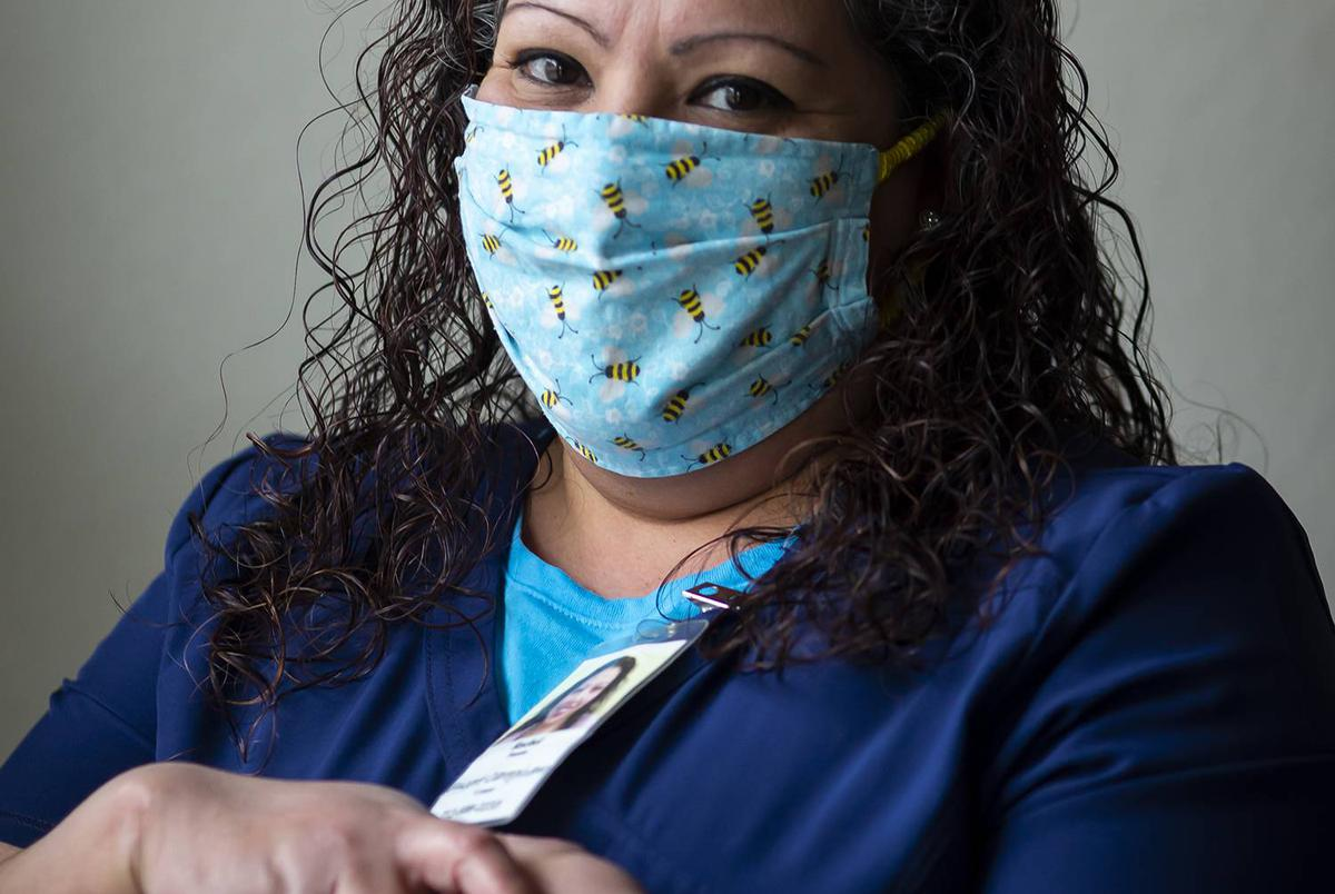 Health care worker Rachel Fuentes in her home in north Houston on Saturday, Feb. 6, 2020. Fuentes has been an in-home caregiver for elderly patients for the past 11 years. She is not eager to get the COVID-19 vaccine and hopes her current or future clients do not depend on it.