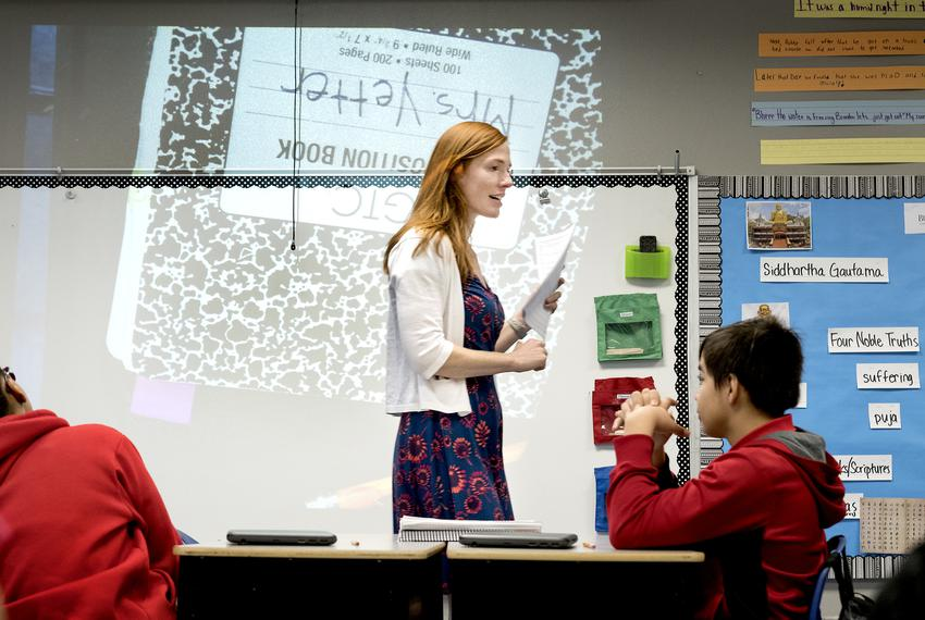 Kate Yetter teaches 5th grade writing at Ogden Elementary in San Antonio. On the left is Amaya'Jaslene Jones and on the right is Ignacio Romo (cq). Bexar County's school districts are among the most segregated in the state, with boundary lines historically drawn to consolidate resources. San Antonio ISD is working to create more socioeconomic and racial diversity through public school choice measures.