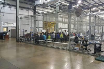 Undocumented immigrant children wait at a U.S. Border Patrol processing center in McAllen.