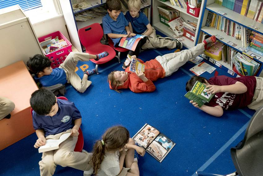 At the Advanced Learning Academy at Euclid in San Antonio, second grade students read while their teacher works individual...