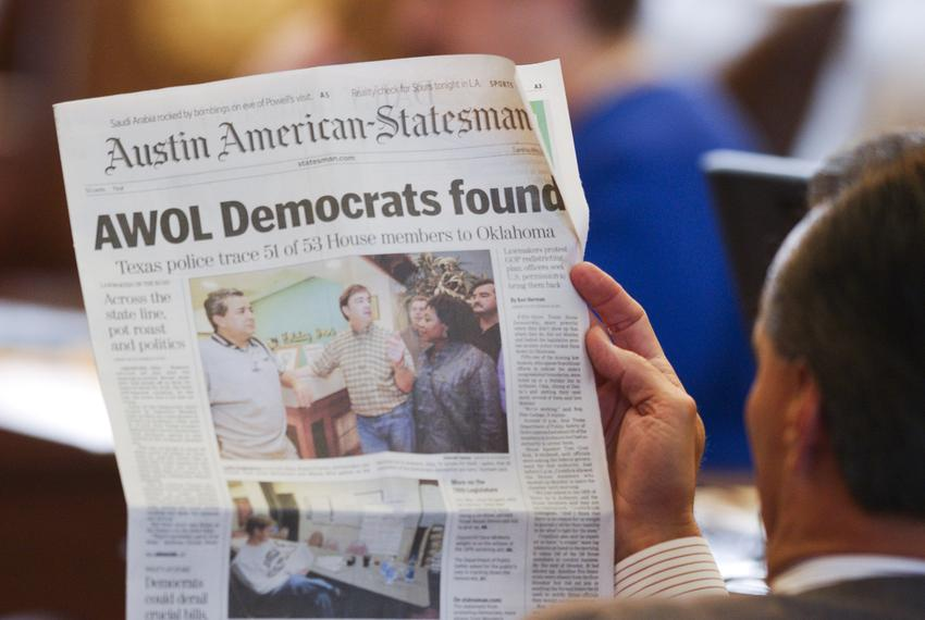 A state representative reads the local paper on the House floor during the Texas House Democratic walkout from May 12-13, 20…
